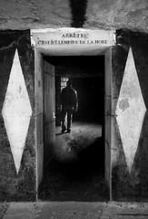 C'est ici l'empire de la mort - Catacombes, Paris, France (pas le matin) Tags: bw nb blackandwhite noiretblanc monochrome paris travel voyage underground catacombes france europe europa dark sombre man homme canon 350d canon350d eos350d canoneos350d
