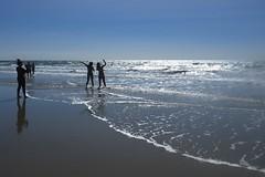 Beach fun @ Port Douglas (Marian Pollock) Tags: australia queensland portdouglas beach sunset people silhouettes sea ocean highlights blue posing photographing shallows waves froth sand