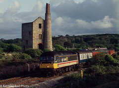 Scotrail in Cornwall (Kernow Rail Phots) Tags: kernow cornwall 47492 class47 scotrail livery whealbusy tin mine tinmine hallenbeagle enginehouse 1923 penzance derby tpo wednesday 3rd june 1992 train trains railway railways railroad mail postal bluegrey red intercity stag summer evening clouds sunny sky trees industrial ruin decay