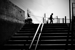 The sun was blazing overhead (明遊快) Tags: dark summer monochrome silhouette contrast step sunlight shadows street sky clouds lines stairs stairway