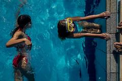 Splash (Spyros Papaspyropoulos) Tags: colour colourphotography color streetphotography streetphotographer street shadows light rethymno crete greece streethunters candid candidphotography ricohgr 18mm photography lightroom photoshop girl woman swim pool