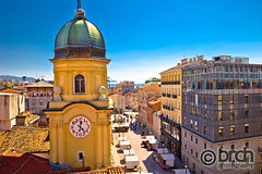 City of Rijeka clock tower and central square (brch1) Tags: rijeka fiume kvarner street architecture city bay aerial harbor historic ancient waterfront palace panorama vacation cityscape croatian tourism town view rock adriatic blue church coast croatia europe mediterranean colorful panoramic dalmatian destination vacations above cathedral tourist sea ocean water yacht marine clock tower central square landmark gate rooftops