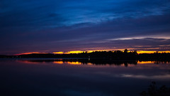 Twilight @ the Lake. (Bob's Digital Eye) Tags: blue bobsdigitaleye canon canonefs1855mmf3556isll clouds dusk flicker flickr june2018 lake lakesunsets reflections silhouette sky sunset sunsetsoverwater t3i twilight water laquintaessenza