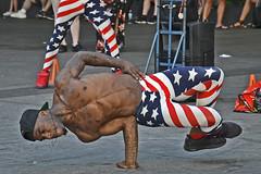 Strong America (t.horak) Tags: black american us usa ny street artist flag limbs stripes stars tattoo muscles man