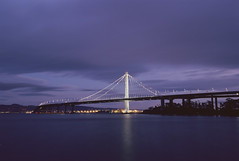 Eastern Span (marq4porsche) Tags: bay bridge oakland san francisco california ca evening twilight long exposure blue hour urban city lights water ocean canon eos 1v ef 1635mm f4 kodak ektar 100 analog film