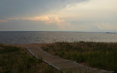 August beach at dusk (yooperann) Tags: lake superior marquette upper peninsula michigan wooden walkway accessible swimming beach city park clouds light breaking through