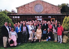 The whole party at Poulton Hall; June Lancelyn Green is seated centre; her son Richard clutches his plastic carrier bag, as usual (photo by Tony Marshall)