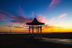 Bandstand field and the Solent (ijpears) Tags: southsea common bandstand castle lighthouse sea skies sky fire fiery clouds sunset reflection reflections water solent portsmouth hampshire silhouette backlit