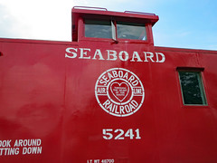 Seaboard 5241 Caboose. (dccradio) Tags: hamlet nc northcarolina richmondcounty outdoor outdoors outside hamletdepotmuseums sky clouds overcast seaboard railroad railfan rail train museum history historical transportation seaboardairline caboose red window windows 5241 canon powershot elph 520hs heart