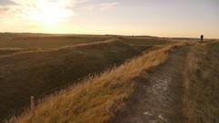 Walking the 'walls' of Maiden Castle (Englepip) Tags: sunset landscape maidencastle vast fort dorset grassland horizon farmland chalk fence rampart