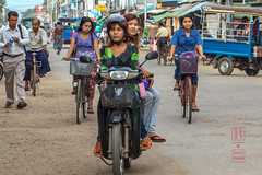 Burmese Women in Sittwe Traffic (shapeshift) Tags: sittwe rakhine myanmarburma mm traffic bicycles motorcycle tuktuk shapeshiftnet shapeshift people women citygirls countrygirls arakan arakanese burma myanmar street streetphotography walking travel candidphotography rakhinestate davidpham davidphamsf documentary