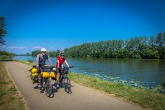 Andrew and Stephanie cycling along the Saóne River in France.