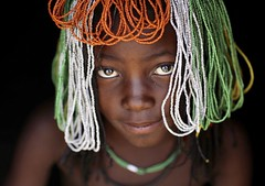 Muhakaona tribe girl with a beaded wig used for the fico ceremony, Cunene Province, Oncocua, Angola (Eric Lafforgue) Tags: africa africanculture africantribe angola angola180093 angolan childhood children colourimage cultures cuneneprovince darkbackground day developingcountries ethnicgroup fico girls headshot horizontal humanbeing indigenousculture jewellery lifestyles lookingatcamera mucawana muhacaona muhakaona nonurbanscene oncocua onechildonly oneperson ongagoa ornate oshiwawbo photography portrait realpeople ruralscene tribal tribe wig