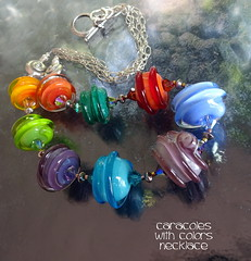 Necklace Caracoles with Colors updated (Laura Blanck Openstudio) Tags: openstudio openstudiobeads murano glass handmade lampwork beads jewelry big huge whimsical funky odd colorful multicolor abstract asymmetric earthy organic boho upscale art fine arts artist artisan made usa nuggets rocks rounds donut bold bright wrapped spiral swirl transparent translucent lilac purple violet teal green blue orange coral lavender lime raised sterling silver urchin round