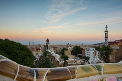 Gaudi's art (MACIEJ WOJCIECHOWSKI) Tags: barcelona spain gaudi architecture parc park guell buildings building panorama famous place view over city town cityscape colourful colours sky skyline orangesky orange blue bluesky evening art day daylight sunset sunlight moon top roof ciel cielo sigma vacation outdoor outside outdoors national light chill amazing atmosphere dusk weather paysage paisaje catalunya classic postcard