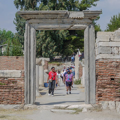The coming hordes (Adaptabilly) Tags: sky ephesus man woman ruins tree travel column people pavement architecture greek efes ephesos turkey door lumixg1 asia