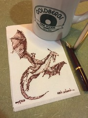 Coffee and a dragon (schunky_monkey) Tags: drawing draw sketching sketch penandink ink pen fountainpen illustration art napkin napkinsketch beast mythical firebreather dragon