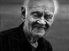 Thinking about the future (Ales Dusa) Tags: man bw streetportrait blackandwhite oldman alesdusa wrinkles outdoor face smile streetshot human people humanity strongcontrast canoneos5dmarkii ef50mmf18stm