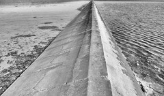 The coast (Duevel) Tags: dijk dike dam coast water bw blackwhite wad wadden mud lowtide sea kust waves golfjes