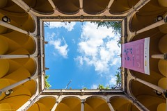 Look-up (alexpekone) Tags: barcelona barcelone catalogne catalunya lookup lookingup architecture architecte patio archi jaune yellow bluesky sky clouds symmetry perspective street streetview art nikon photography photographie travel tourism espagne europe