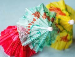 Primary Color Paper Umbrellas (Maureen Medina) Tags: maureenmedina artizenimages paper umbrellas tiki drink decoration yellow red blue closeup dof