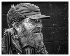 Bertie (AEChown) Tags: fisherman thestade hastings monochrome mono blackandwhite portrait profile beard cap documentary hat textures