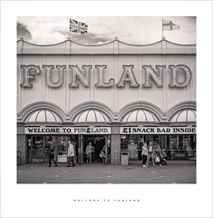 Welcome to Funland (Parallax Corporation) Tags: southportpier silcocks amusements arcades seaside blackwhite monochrome tourists holdaymakers neonlights funland flags unionjack sonya7rii sonyfe85f18