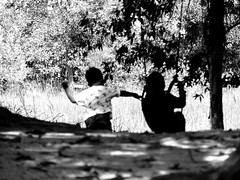 Swing push (A. Yousuf Kurniawan) Tags: kid kidworld silhouette children park playground blackandwhite monochrome play fun swing decisivemoment streetphotography rurallife borneo kalimantan banjarbaru backshot