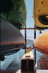 kayaks (apostolos.tourtouris) Tags: kayak color exposure film 35mm filmisnotdead sea blue colors ruleofthirds kayaking greece