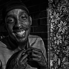 """""""The Spirit Speaks Its Truth In Silence And Radiates Its Beauty Through Smiles And Blossoms"""", Martin Luther King Jr. Avenue, Historic Anacostia, Washington, DC (Gerald L. Campbell) Tags: streetphotography street squareformat spirituality spiritualindifference socialdocumentary socialjustice alienation aloneness bw blackwhite blackmale citylife community dc digital freedom historicanacostia indifference injustice inequality justice martinlutherkingjravenue portraitphotography portrait urbanphotography urban unitedstates washingtondc yearning yeswecan youth canonsx60hs"""