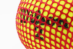 Into the net (Rod Anzaldua) Tags: macro macromonday macromondays ball tennis mesh net red yellow white