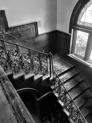 This 1895 mansion was built with a small ballroom on the top floor. Orignally built as a family home, it also had been a funeral home, and a social services shelter. (neilsharris) Tags: abandonedchicago