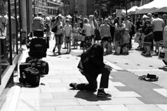 Pulling in The Crowds (WorcesterBarry) Tags: blackwhite bnw blackandwhite city candid street streetphotography streetphoto shadows streetartist travel adventure reflection