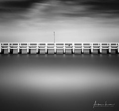 Nieuwpoort Pier IX (Alec Lux) Tags: bw beach belgium blackandwhite blackandwhitephotography breakwater coast coastline concrete groyne jetty landscape landscapephotography longexposure longexposurephotography nature naturephotography nieuwpoort ocean pier poles pontoon sand scenic sea seascape seascapephotography sky smooth water waves be