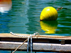 Buoy and boat (Marite2007) Tags: spetses saronic islands greece buoy yellow boat reflections water sea closeup buoyant