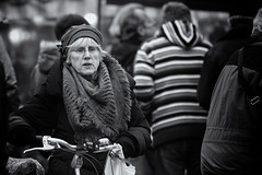 Wheeling her bicycle (Frank Fullard) Tags: frankfullard fullard candid street portrait bike bicycle older lady scarf hat cap monochrome elderly blackandwhite blanc noir shopping market