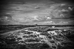 A distant view (Missy Jussy) Tags: northumberland northeastcoast clouds sky windfarm windmills house ruins people view sanddunes sand grass hills landscape mono monochrome moodylandscape moody atmosphere blackwhite bw blackandwhite buildings 5d canon5dmarkll canon5d canoneos5dmarkii canon ef50mmf18ii