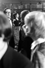 011471 27 (ndpa / s. lundeen, archivist) Tags: nick dewolf nickdewolf blackwhite blackandwhite 35mm film photographbynickdewolf bw january 1971 1970s boston massachusetts party socialaffair socialevent socialengagement socializing blacktieaffair trainstation trainstationlobby lobby waitingroom terminal privateevent people fundraiser backbay backbaytrainstation champagneball southendhistoricalsociety dancer dancers dancing couple couples man men woman women youngwoman dress sleevelessdress tux tuxedo glasses eyeglasses dancefloor sideburns brunette longhair blond blonde windows ticketwindows