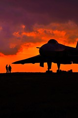 Silhouette of the formidable Vulcan Bomber against the Angry sky... (mlcphotography666) Tags: altitude flying landing takeoff sunset peace war runway airport clouds mission destruction raf england avro pilot speed power red sky bomber vulcan