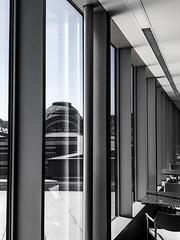 At the Tacoma Art Museum (ScottElliottSmithson) Tags: reflection window vanishingpoint cityscape tacomaartmuseum iphone dtwpuck scottelliottsmithson bw blackandwhite geometry monochrome washingtonstate pacificnorthwest washington unionstation tacoma