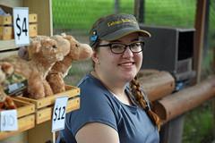 Selling Camels (MTSOfan) Tags: woman smile vending vendor stuffedanimals plushanimals camels lvz