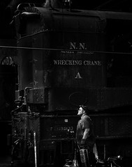 024693763640-103-Working on the Train-2-Black and White (Jim There's things half in shadow and in light) Tags: america ely nevada nevadanorthernrailwaymuseum southwest usa whitepinecounty history locomotive museum rail steam man blackandwhite train people work