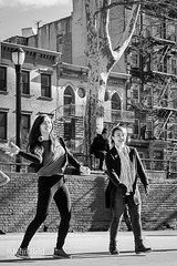 Playing Handball, Chinatown, Manhattan, NYC  (86143-BW) (John Bald) Tags: bw chinatown competition hesterstreet hesterstreetplayground manhattan newyork newyorkcity blackwhite blackandwhite daytime exterior girls handball streetphotography winter youngwomen