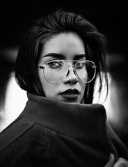 That Stare (seekerofeast) Tags: eyes lady woman portrait black white grey blackandwhite shades tones texture art glasses lips sunset dusk dawn light winter august fall autumn city ew new york people macro bw fly line curves bnw nikon dslr