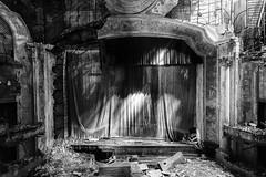 curtain call. (stevenbley) Tags: urbanexploration urbanexploring urbex urban historic movietheater theater theatre newjersey jersey nj canon5dmarkii 5dmk2 seats curtains riots city mold rust mildew history decay raceriots bw blackandwhite monochrome