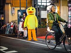 Osaka Evening (David Panevin) Tags: sennichimae chūōku 中央区 大阪 osaka kansai japan olympus omd em1 mzuikodigitaled45mmf18 street path evening night people costume duck shops signs bicycle urbanfragments davidpanevin