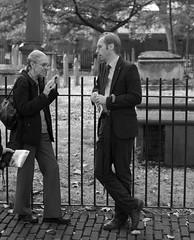 Conversations on the edges (IanAWood) Tags: centrallondon flaneur london nikkorafs56mmf14g nikondf pbwa streetphotography thecityoflondon walkingwithmynikon