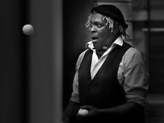 juggler (heinzkren) Tags: panasonic lumix schwarzweis blackandwhite bw sw monochrome street streetphotography dark art streetart candid london people man mann portrait face coventgarden artist urban künstler strasenkunst lowkey uk