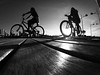 Sunny bike ride B&W (alestaleiro) Tags: boke mono bycicle bicicleta ride women sunset controluce contraluz sun sol sole sunny magrela girls molhe muelle barrasul balneáriocamboriú sc monocromo monochrome bw bn pb alestaleiro