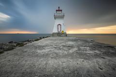 Southampton Lighthouse at sunset (angie_1964) Tags: southampton lighthouse sunset sky cloud pier nature seascape water longexposure nikond850